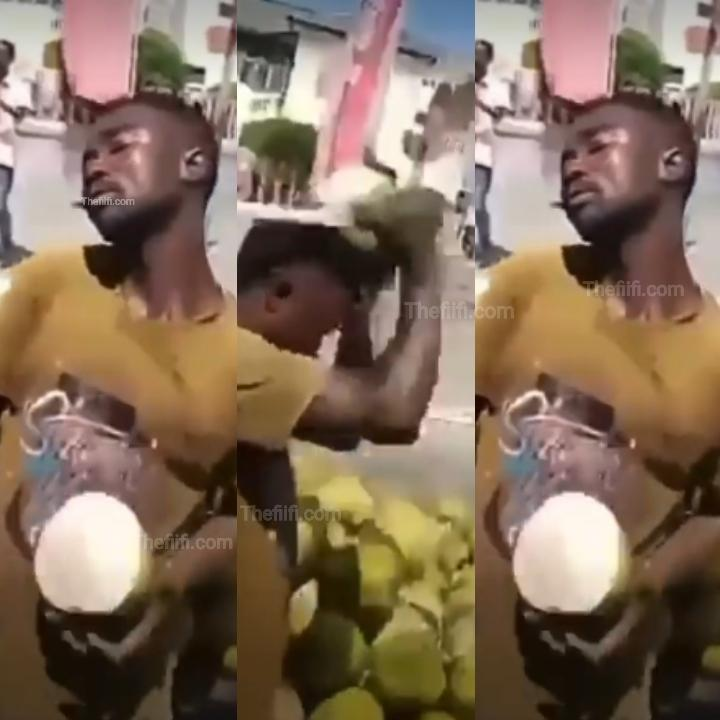 Video: Coconut Seller Skillfully Peels Coconut On His Head & It's Amazing